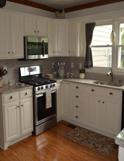 kitchen in white with end panels.